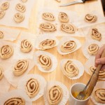 Glazing cinnamon whirls with egg