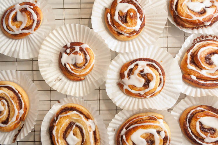 Cinnamon whirls with icing drizzled on top